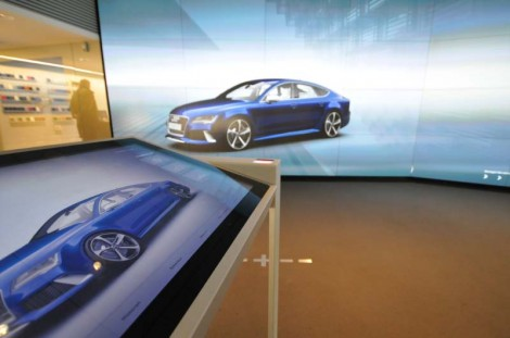 Audi City in Berlin: touch screens allow you to configure your vehicle and project the result onto a life-size wall