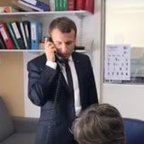French President Macron listens to his customers